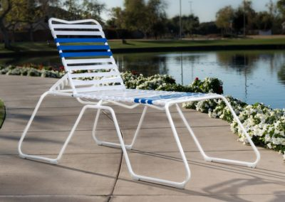 The Martin™ High Chaise Lounge Chair outdoors by a pond